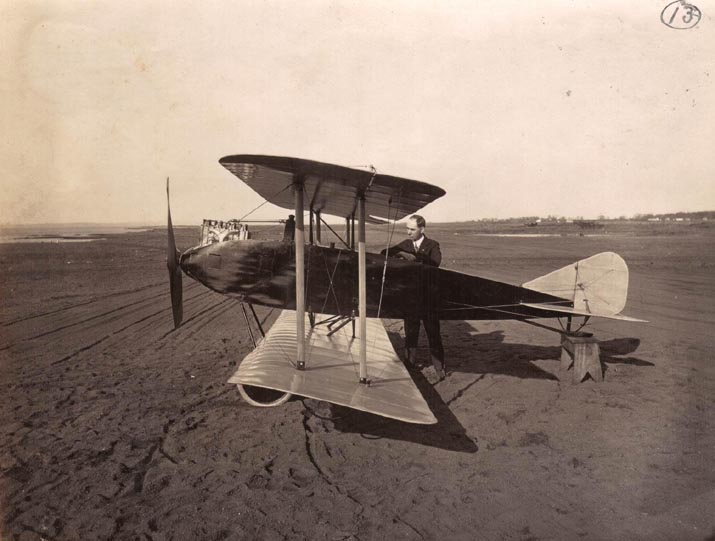 Hugh Robinson w/Aeromarine Model R-13 outside the Aeromarine factory, Keyport, 1917